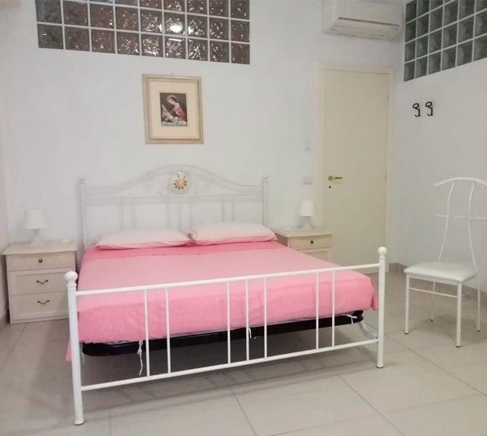 Camera dell'appartamento in Via Risorgimento